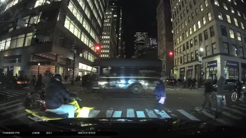 motorcycle doing a donut in the middle of the street in new york